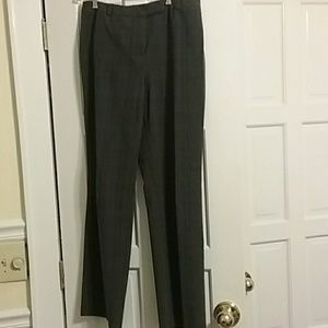 Gray pants with black and white pinstripes